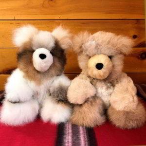 2 Alpaca fleece teddy bears sitting side by side